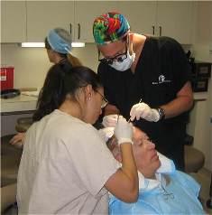 Dr. Bauman performing surgery